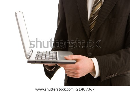 A business man holding a silver laptop isolated on white
