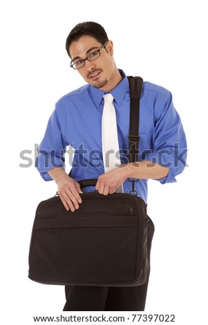 A business man is holding a bag with a serious expression.