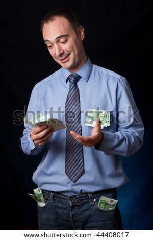 A business man is surprised and very happy because is has just earned a lot of money. His pocket are full of wads. Conceptual image for business success, rich people, income, ...
