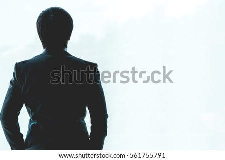 A business man is using the phone to work. - Shutterstock ID 561755791