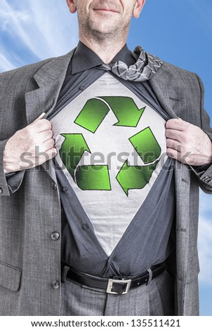 A business man opens his shirt to show off his recycle concept.