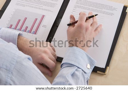 A business man reading through a contract
