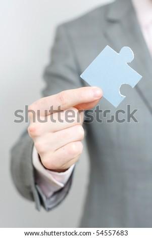 A business man solving a puzzle