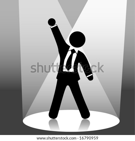 A business man symbol raises his fist in celebration of success on stage in a spotlight. Includes a clipping path of the person.