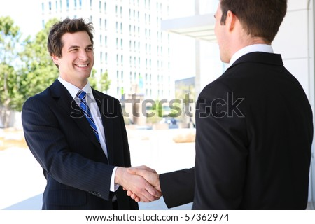 A business man team at office shaking hands - stock photo