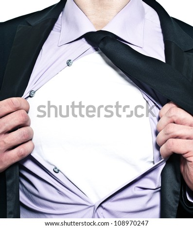 A business man tears open his shirt in a super hero fashion