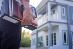 A business man took home fags, documents and workbooks. Work from home policy