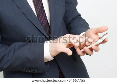A business man typing on cell phone