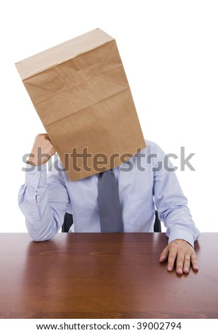 A business man with a cardboard bag on his head with a pensive expression
