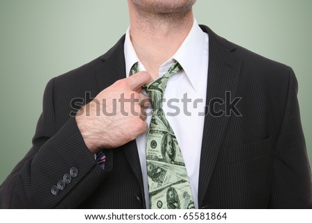 A business man with a conceptual money themed tie