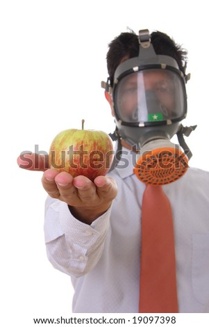 A business man with a mask holding a genetic manipulated apple