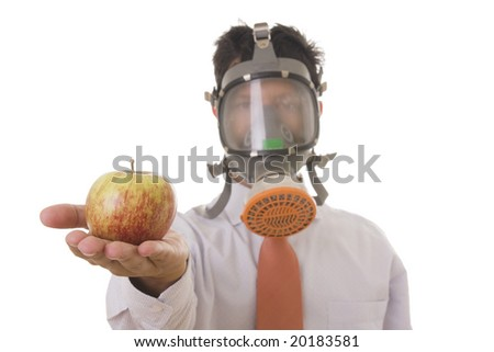 A business man with a mask holding a genetic manipulated apple (focus on the apple)
