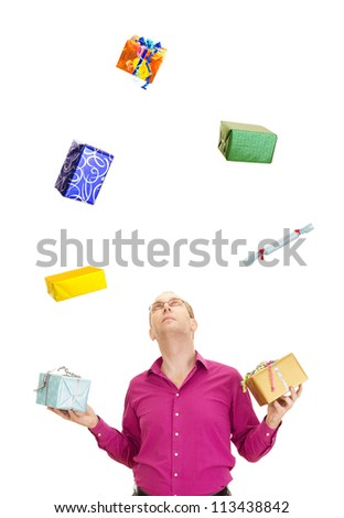 A business person juggling with some colorful gifts