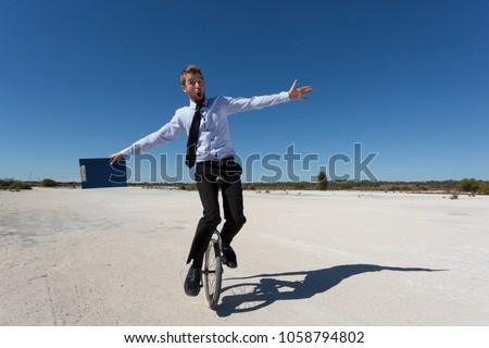 A business person riding a unicycle.