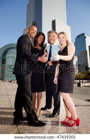 A business team giving a thumbs up showing success