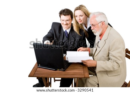 A business team looking at a laptop