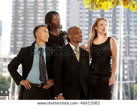 A business team looking to the side or into the distance