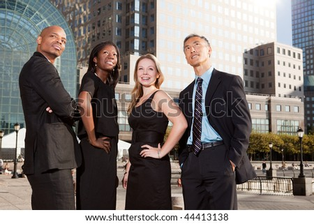 A business team looking up into the future