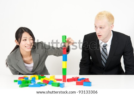 a business team making building block isolated on white background