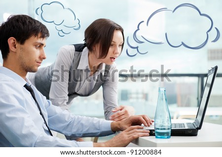A business team of two colleagues planning work in office. Blank cloud balloons of their dialog for your text and logo