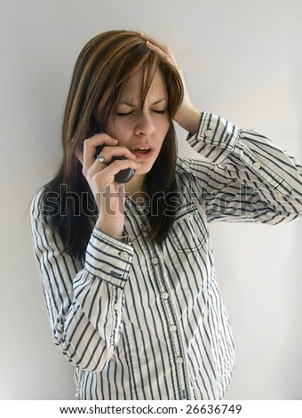 A business woman getting bad news on her cell phone