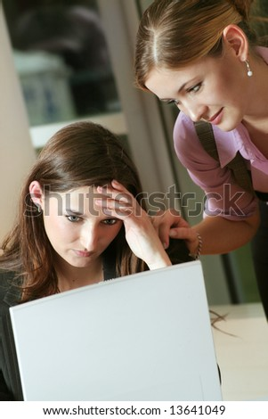 a business woman is frustrated on a table with a laptop