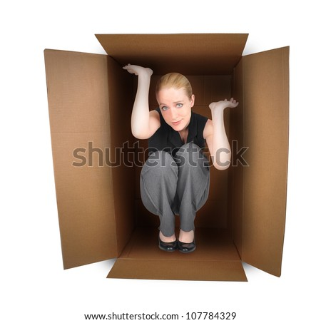 A business woman is trapped in a small box with anxiety on a white background. Use it for a employment or pressure metaphor.