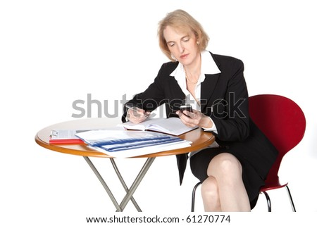 A business woman is working and doing telephone calls