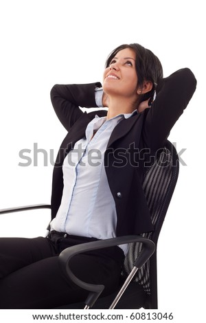 A business woman leaning back in a black chair dreaming