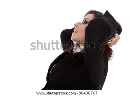 A business woman leaning back in a black chair dreaming, side view