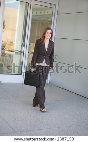 A business woman leaving the office for the day