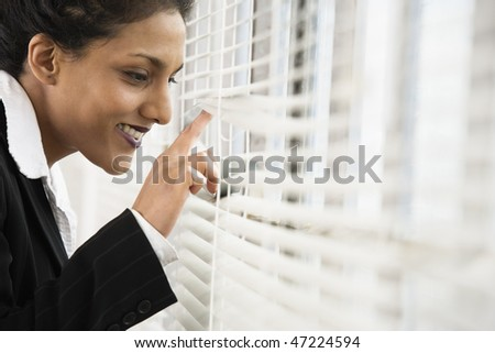A business woman looking out from a window.