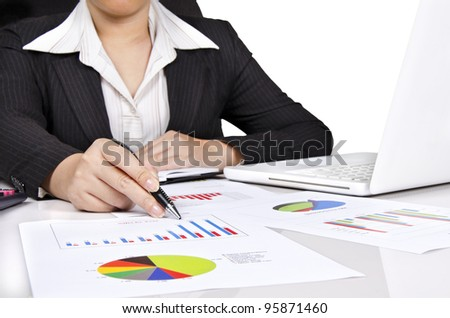 Photo of a business woman showing business chart on her desk