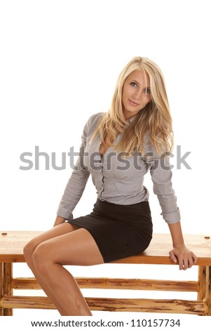 A business woman sitting on a bench with a small smile playing on her lips.