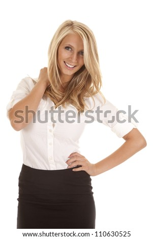 A business woman standing with a smile on her face with her hand on her hip.