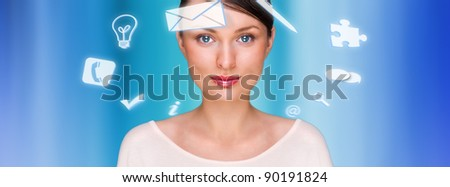 A business woman with icons  of her affairs floating around her head. Portrait of pretty girl working with her virtual pc looking at camera and smiling. Daily deals online.