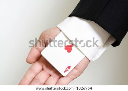 A businessman carrying an ace of hearts - stock photo