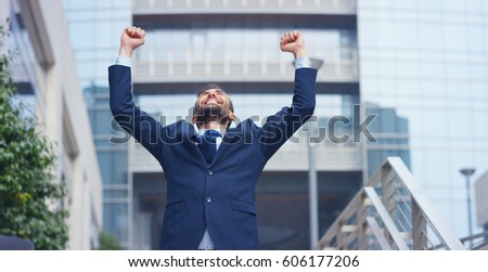 A businessman dancing in the square and is glad to have received a promotion or winning a bet. Concept: finance, business, elation, victory, wager, career, dance