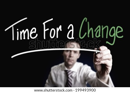 A businessman drawing a Time for Change concept on a glass screen.