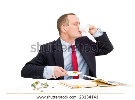 A businessman drinking a cup of coffee in a hurry