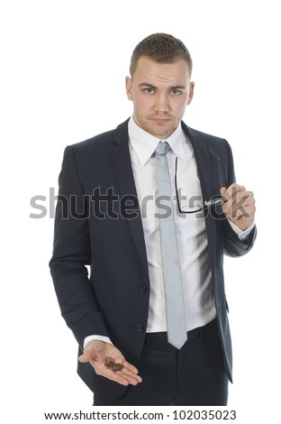a businessman expressing poverty, he holds some coins in his hand