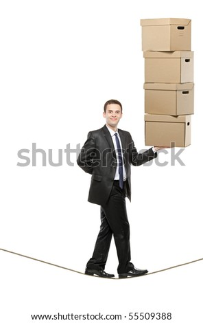 A businessman holding paper boxes and walking on a rope isolated on white background