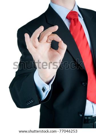 A businessman holding up an OK sign