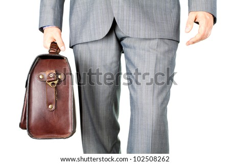 A businessman in a business suit carrying a briefcase (Isolated business background)