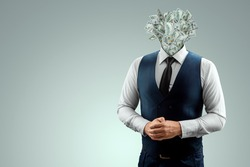 A businessman in a business suit with banknotes instead of a head, a head made of dollars. The concept of money addiction, working only for money, business, startup, career