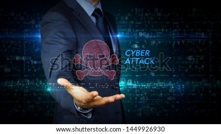 A businessman in a suit and screen with pirate skull symbol hologram. Man using virtual display interface. Cyber attack, online crime, theft and fraud, piracy in cyberspace concept.
