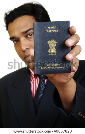 A businessman in a suit holds a new Indian passport!