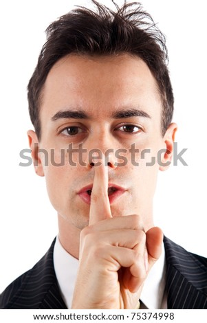 A businessman is asking for silence. Isolated on white.