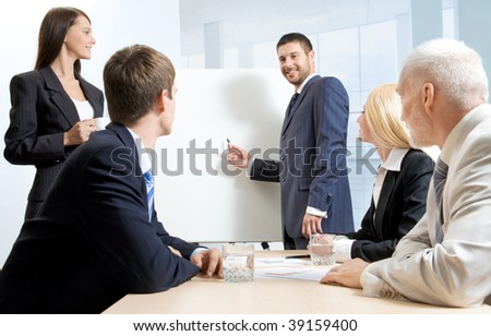 A businessman making a report and four people listening to him