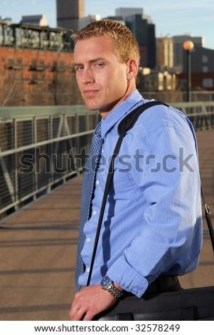 A businessman on a bridge to the city